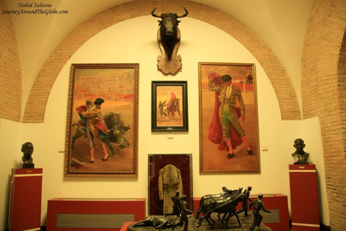 Seville Bullring Museum, the front statue shows how mules pulls away bull after it is killed in a bullfight