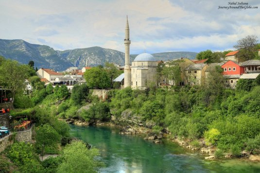 Standing on Stari Most or Old Bridge of Mostar in Bosnia and Herzegovina