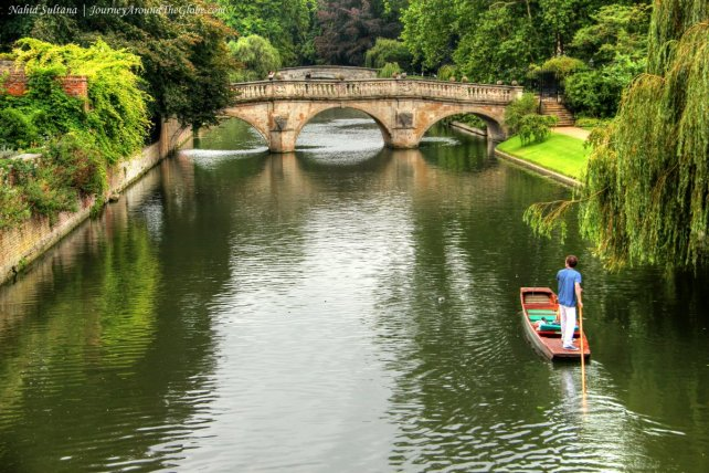 A man punting on River Cam in Cambridge, England