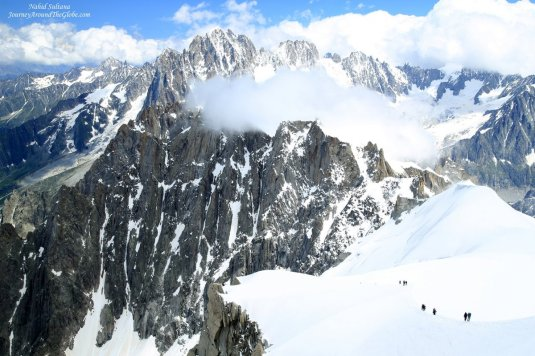 Looking at the hikers and climbers on Mont Blanc massif from our tramway