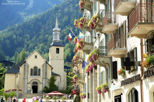 Catholic Church of St. Michael and Chamonix Town Hall on the right in Chamonix, France