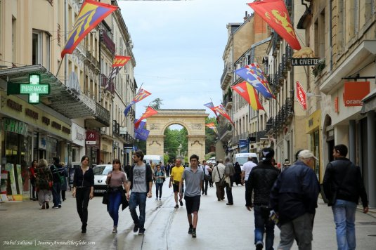 Rue de la Liberte and La Porte Guillaume in old town of Dijon, France