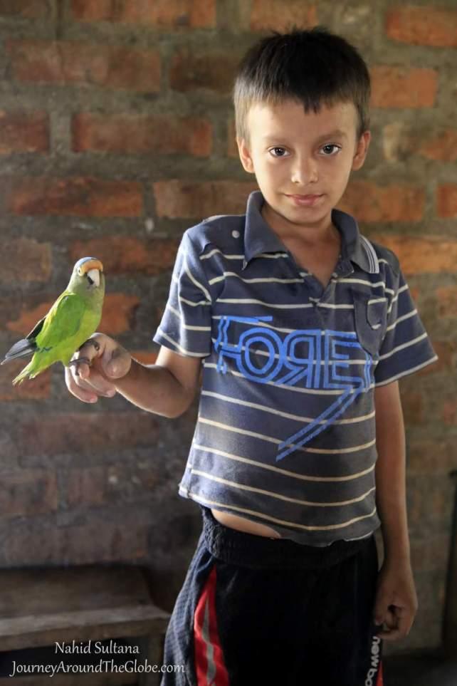 A little boy I met in Wasapa, with his pet parrot...Wasapa, El Salvador