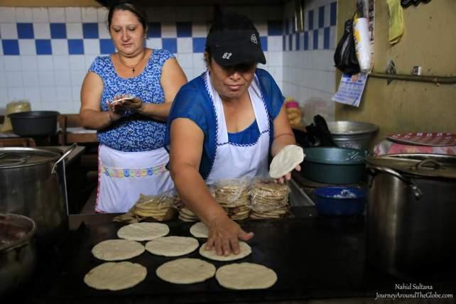 Women making tortilla inside Marcado Municipal de Suchitlan in El Salvador