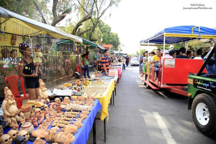 Street full of souvenir shops with full trinkets outside Tazumal Archeological Park in El Salvador