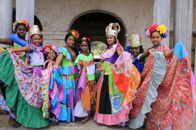 Girls in Portobelo, Panama in their colorful ethnic outfits