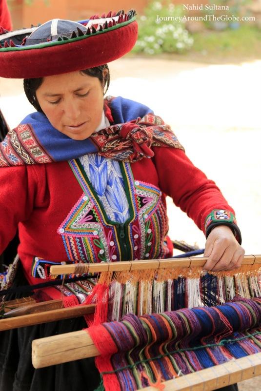 A weaver working with alpaca wool at Figueroa Alpaca Textile in Peru