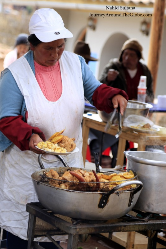 A lady in Chinchero market selling street food
