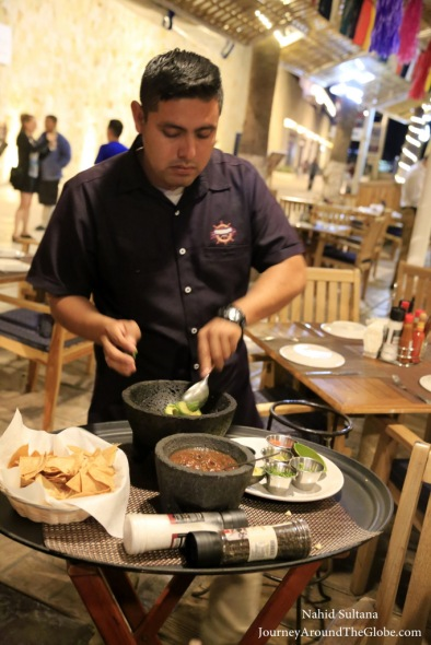 Our waiter making fresh guacamole for us in Fisherman's Landing in Cabo, Mexico