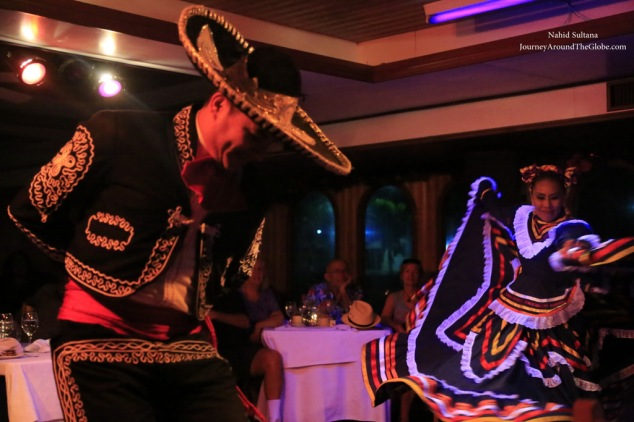 Traditional Mexican folk dance in Sunset cruise in Cabo, Mexico
