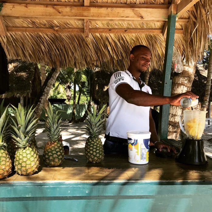 A local making fresh pineapple juice for us in Saona Island, DR