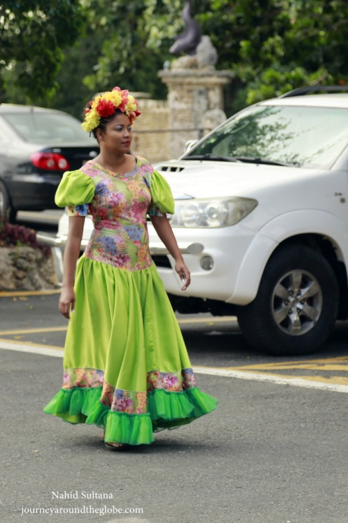 A local wearing traditional Dominican dress in Punta Cana