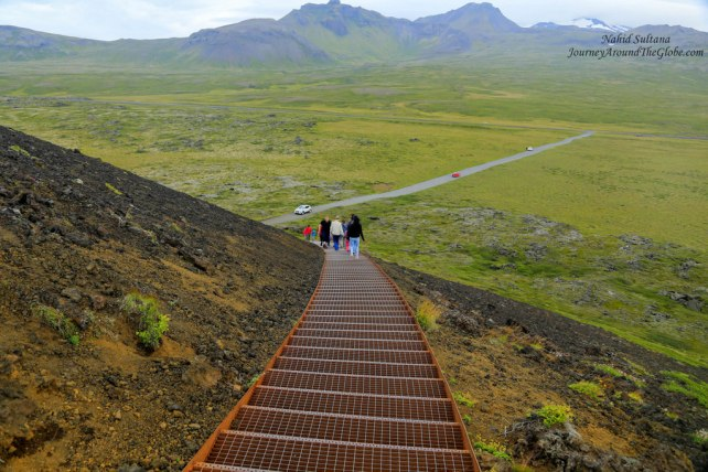 Going up the stairs to Saxholl Crater in Iceland